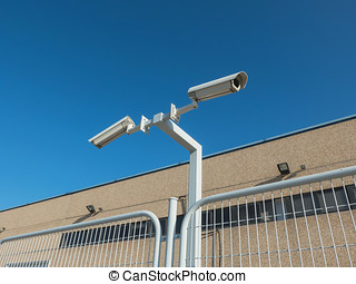 Security cameras in the fence of a private property
