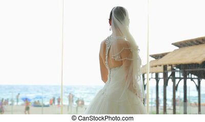 Bride On The Beach - Bride in a white dress on the beach