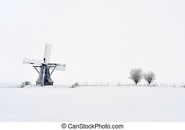 Dutch windmill in winter ( Friesland The Netherlands)