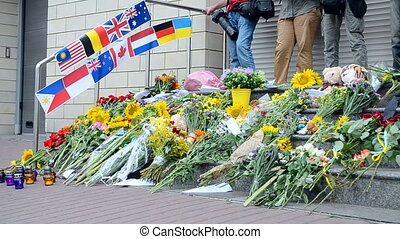 Flowers and candles memorial. - Flowers and candles...