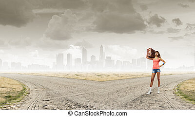 Young free hitchhiker - Traveler woman walking with retro...