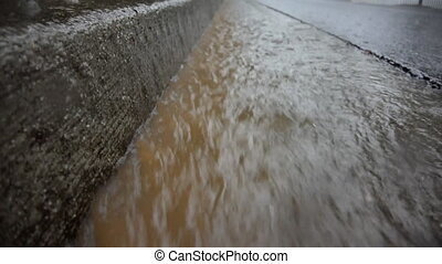 Rain in Gutter Loop - During a heavy rain, muddy water flows...