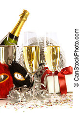 Glasses of champagne with mask and gift