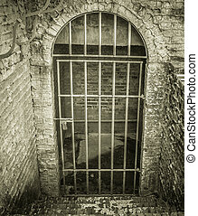 Fear - Stone stairs lead to a locked dungeon style cell with...