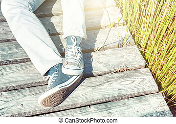 Summer landscape with relaxing teenager
