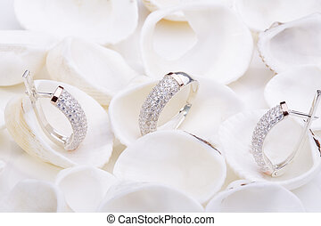 Jewelry. - Beautiful gold ring and earrings with diamonds on...