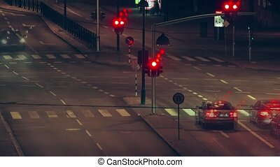 Street traffic at night, Time lapse - City street crossroad...