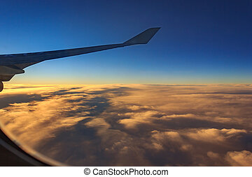 aircraft wing with cloudy