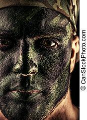 battle khaki - Close-up portrait of a brave soldier in war...