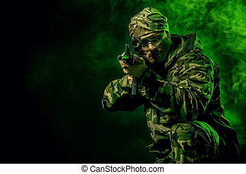 shooter - Brave soldier in camouflage holding automatic...