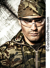 soldier - Masculine soldier in camouflage. Military, war.