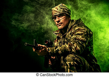 special forces - Brave soldier in camouflage holding...
