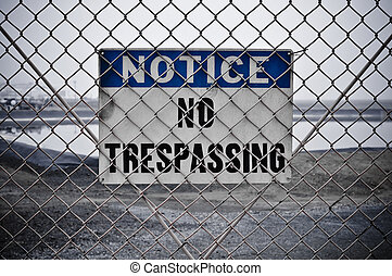 No Trespassing Sign - Dingy No Trespassing Sign in Front of...