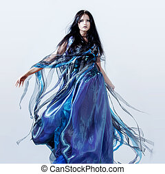 Fashion photo of young magnificent woman in blue dress....