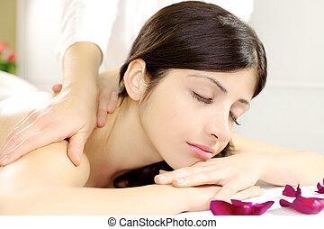 Closeup of beautiful woman relaxing during massage