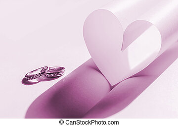 wedding rings and heart Concept of love - wedding rings and...