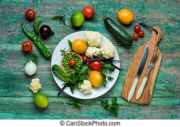 Fresh Organic Vegetables on a White Plate with Knife and...