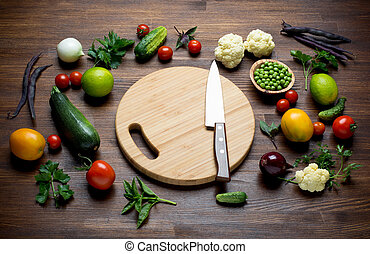 Fresh Organic Vegetables on awooden table with cutting board...