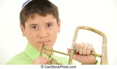 Trumpet Player - Boy playing the trombone On the childs head...