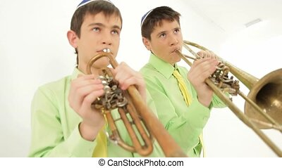 Two Trumpeters - Two boys playing on brass instruments....