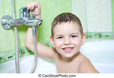 Water treatments - The boy in the bathroom, with an...