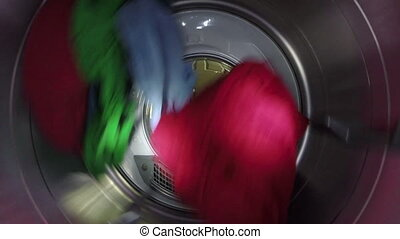 Slow Motion of Clothes In Dryer - Brightly colored clothes...