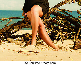 Woman legs on beach. Slim body foots summer outdoor.