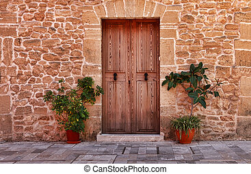 Alcudia Old Town - Wooden door of an old stone house