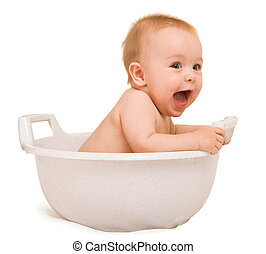 baby having bath - Cute baby having bath in white tub
