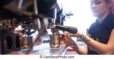 young girl Barista prepares coffee in pub, bar, restaurant -...