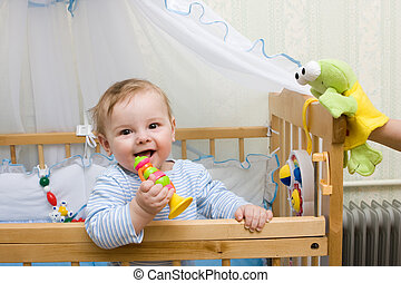 Little boy - Cute little boy playing with toys in his crib