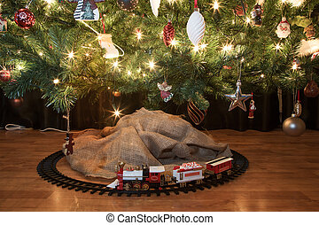 Christmas train - Toy train beneath a decorated christmas...