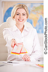 Travel agency - Female travel agent sitting at office and...