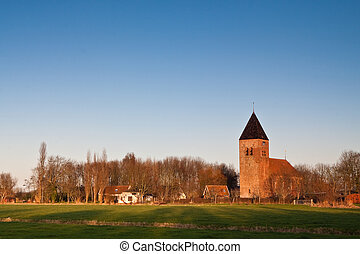 Small vilage in the countryside with church