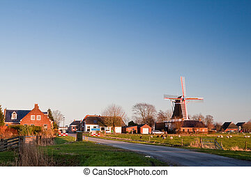 Small vilage in the countryside with windmill