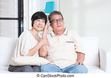 Senior using smart phone