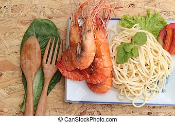 Pasta spaghetti with shrimp on the plate