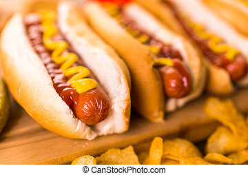 Hot dogs - Grilled hot dogs on a white hot dog buns with...