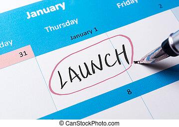 Launch word written on calendar using pen