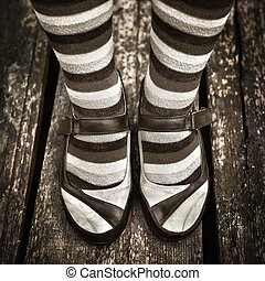 black and white Female legs in striped socks in vintage style