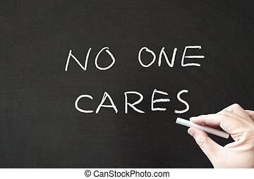 No one cares words written on blackboard using chalk