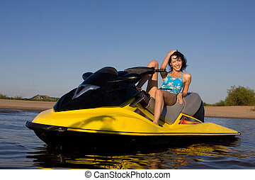 Jet ski - Young smiling beautiful girl on the jet ski