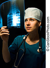 x-ray - female doctor with x-ray image on black background