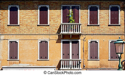 windows doors and terrace of ancient house in Murano