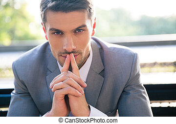 Portrait of a thoughtful businessman outdoors - Portrait of...