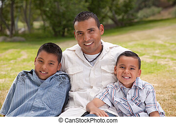 Hispanic Father and Sons in the Park