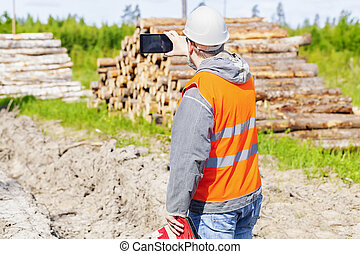 Forest engineer with tablet PC