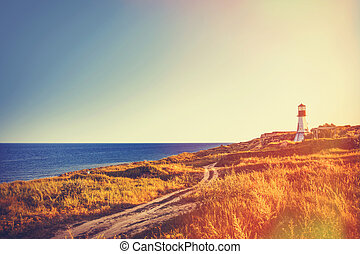 lighthouse near a sea in autumn time - View on old...
