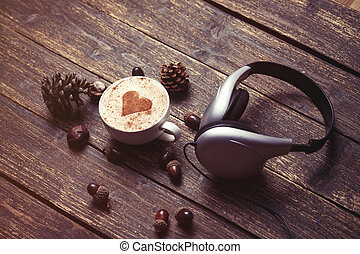 Cup of coffee and headphones - Cup of coffee with heart...