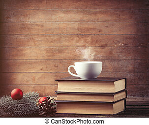 cup of tea with christmas tree brench and books - Hot cup of...